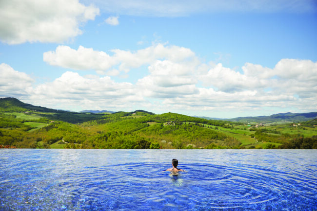 Infinity pool of an exclusive wedding resort in Tuscany