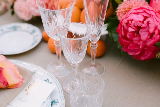 Sophisticated table setting with silver cutlery and sage color tableclothes