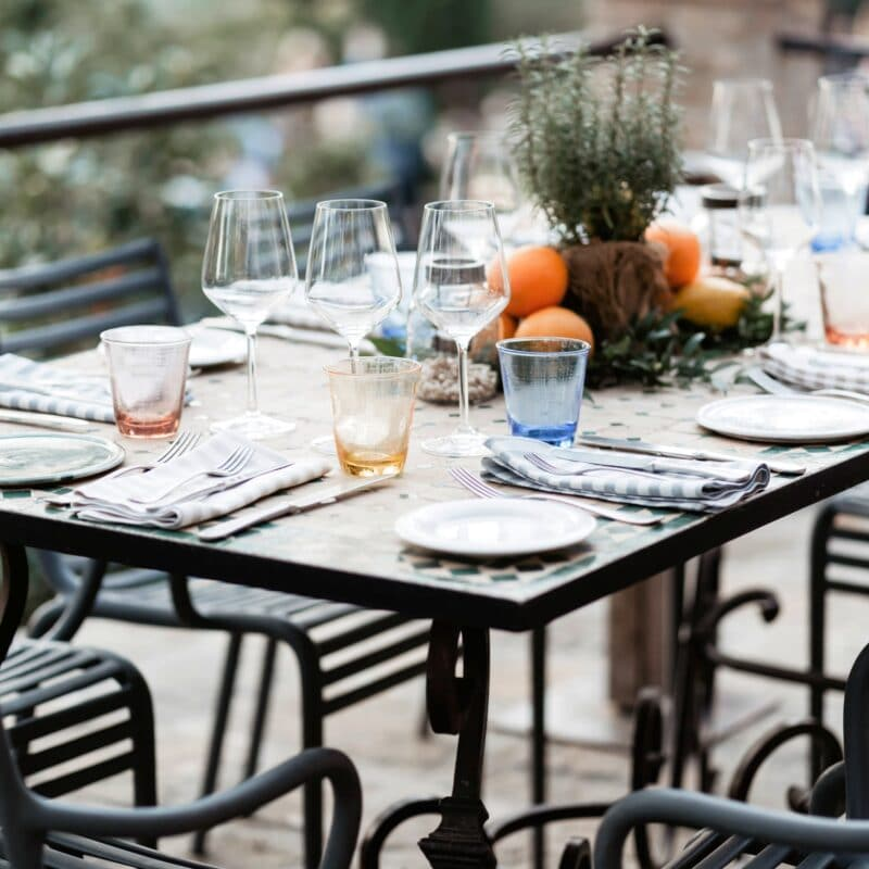 welcome wedding dinner setting with iron table and chairs and decor with herb