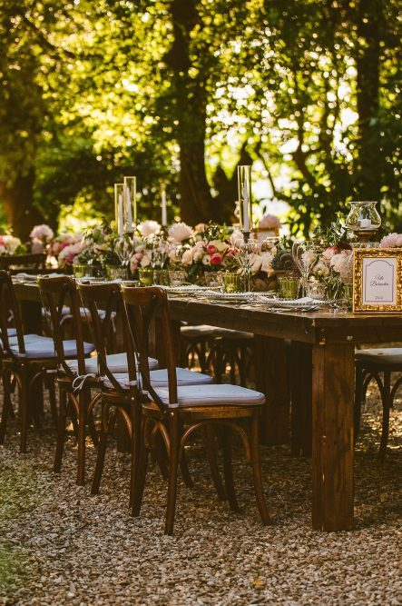 Wedding decor detail with wooden tables