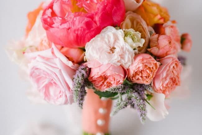 Ivory, coral and pink flowers bridal bouquet