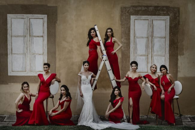 Bride with bridesmaids in red attire