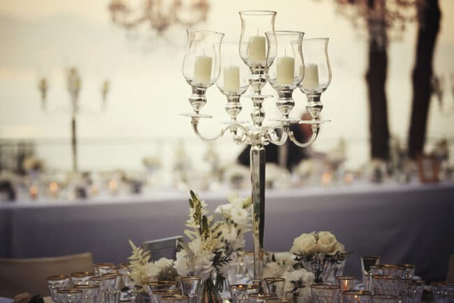 Silver candelabras and ivory flowers as wedding decor