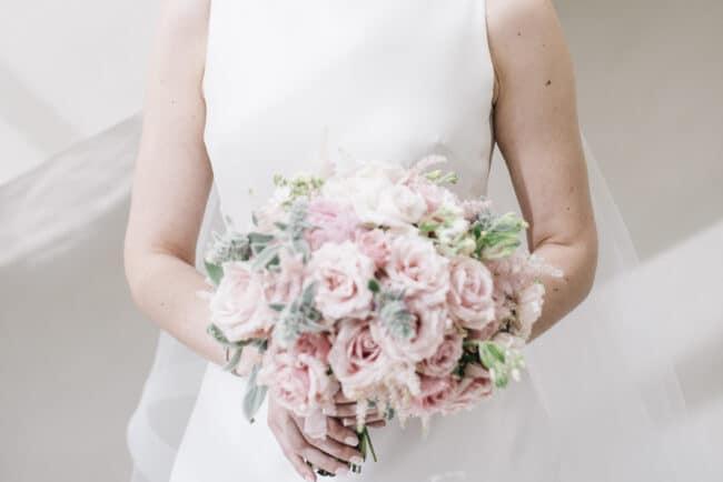 Romantic bride with flower bouquet
