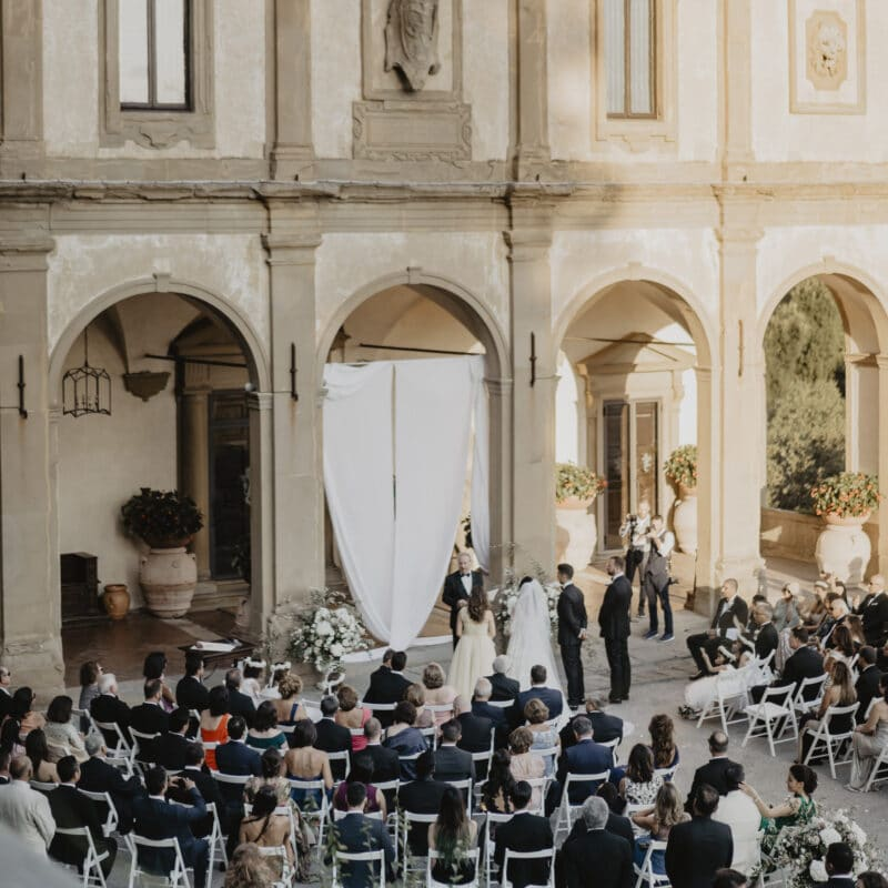 Outdoor ceremony with semicircular chairs layout