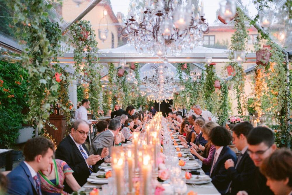 Wedding guests at the elegant candlelit dinner