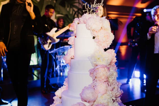 Exclusive wedding cake with cascading pink flowers