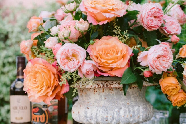 Bar station decor with orange and white flowers