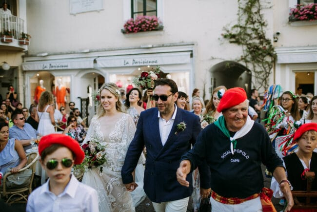 Bride and groom with a typical folk band in Capri