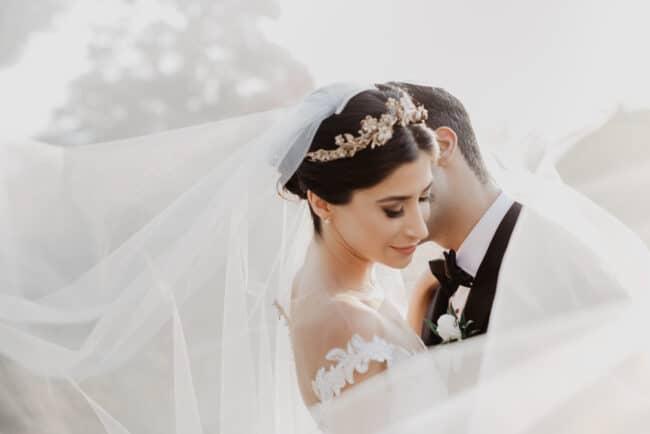 Iranian ceremony: groom kisses the bride