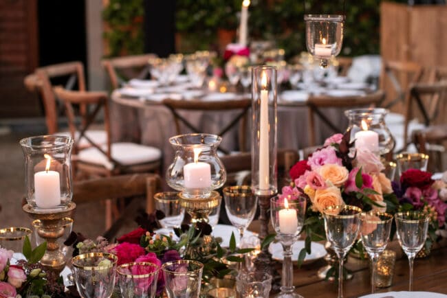 Tables with hanging candles and purple flowers
