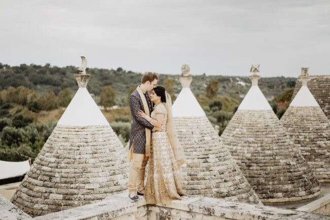 Indian bride and groom among Trulli, Puglia