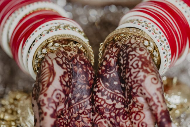 Indian bride hands with henna