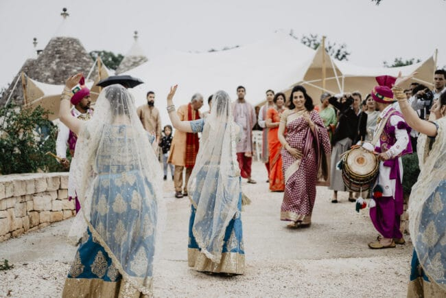 Indian dancers in a Hindu wedding in Italy