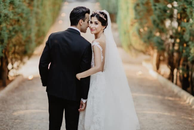 Indian wedding: newlyweds embracing photography