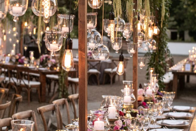 Wedding table with bulblights and hanging candles