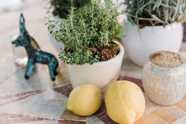 Table decor with lemons and herbs