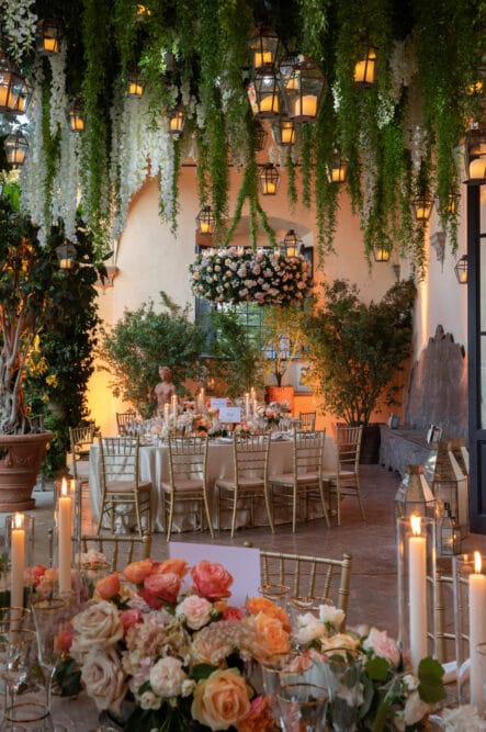 Hanging greenery and lanterns for a secret garden wedding decor in Italy
