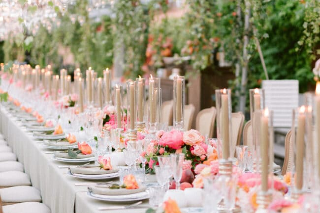 Luxury top table with chandeliers and cascading greenery