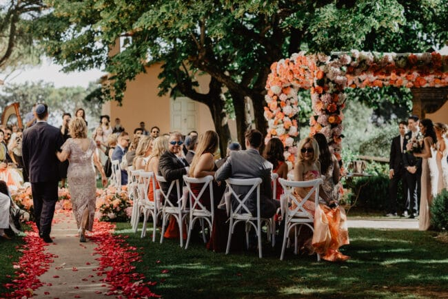 Chuppah with coral, pink and ivory flowers