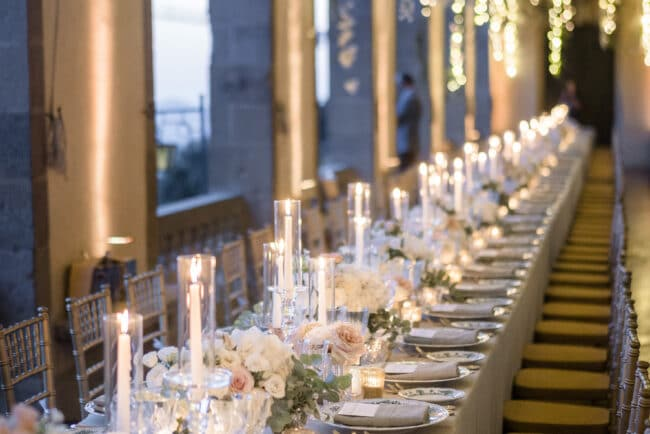 Luxury wedding table setting with cascading fairylights in Italy