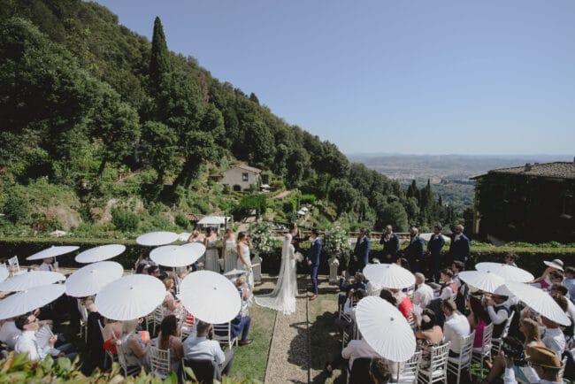 Outdoor wedding with sun umbrellas in Italy