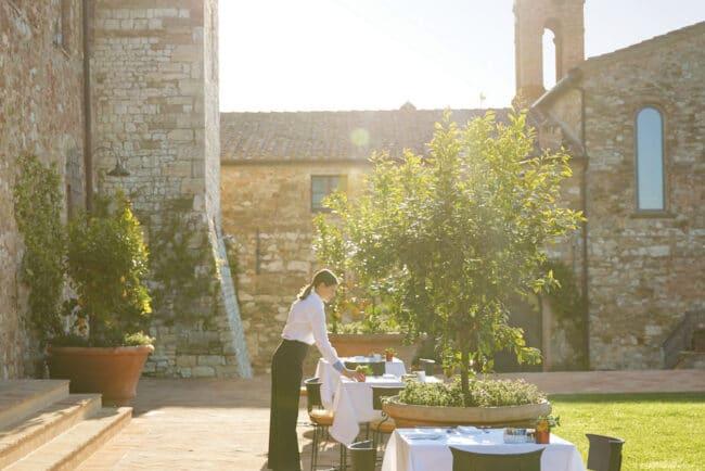 Outdoor restaurant in a garden in Tuscany