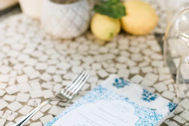 Printed menu and lemons decor for a welcome wedding dinner in Ravello