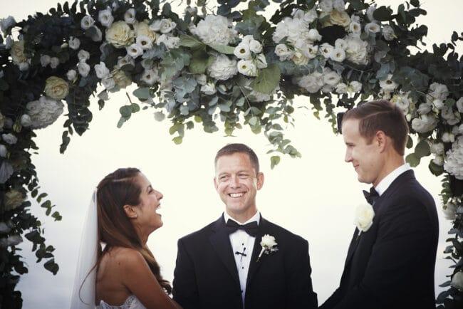 Wedding ceremony in Portofino with romantic flowers arch