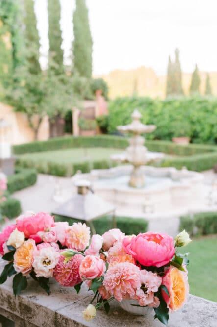 Italian style romantic garden with fountain in Italy