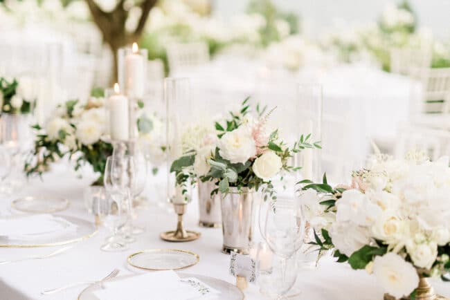 Wedding dinner table decored with white flowers