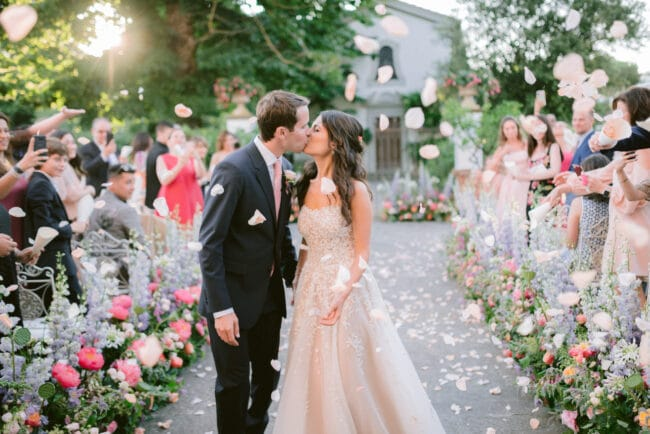 Wedding ceremony setting with colored flowers
