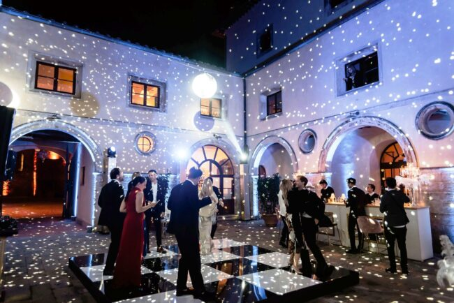 party in the courtyard of a wedding venue in tuscany