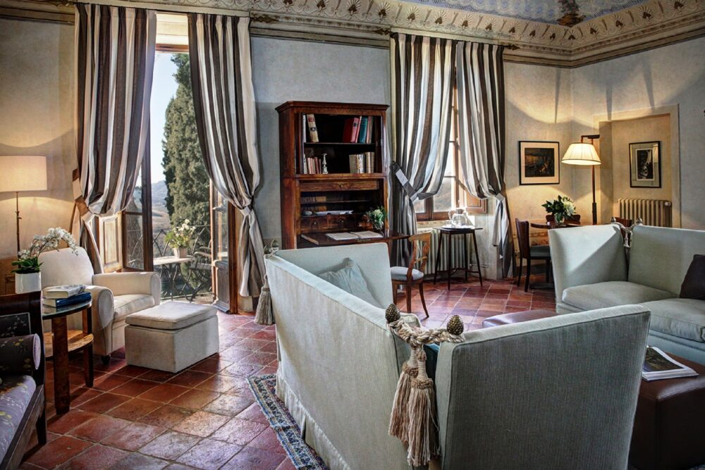 Elegant suite for with grey sofas for romantic wedding in tuscany