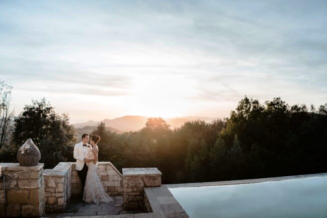 swimmingpool with view at the sunset in tuscany