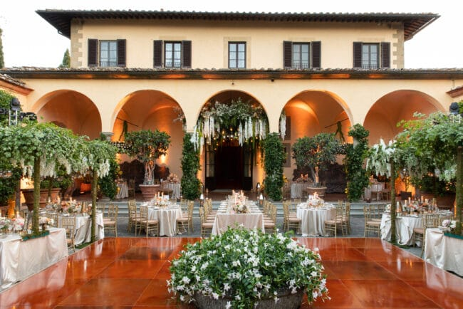 Courtyard decorated as a secret garden for a wedding in Italy