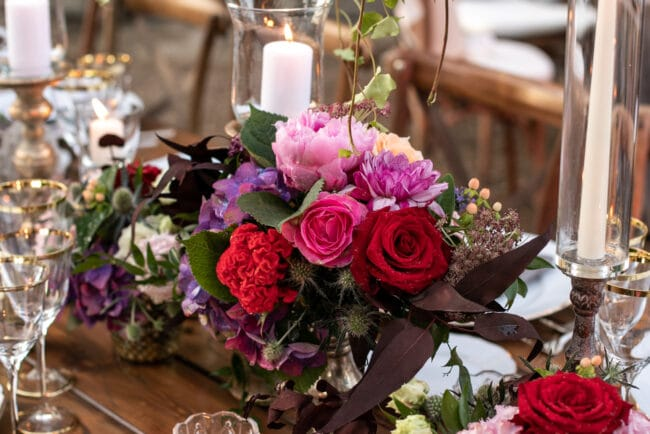 Wedding table decor with colored flowers