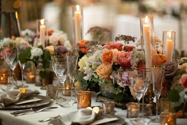 Salmon, peach and violet flowers palette for a wedding table decor in Italy