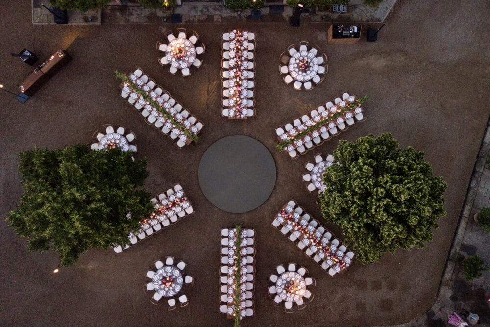 Top view of rectangular and round tables of a Tuscan wedding villa