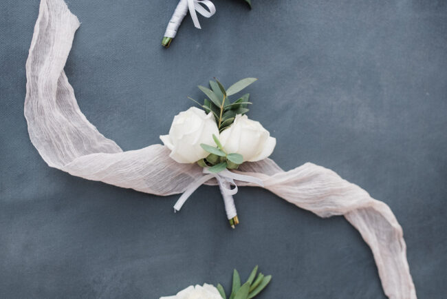 Elegant white buttonhole and coursage