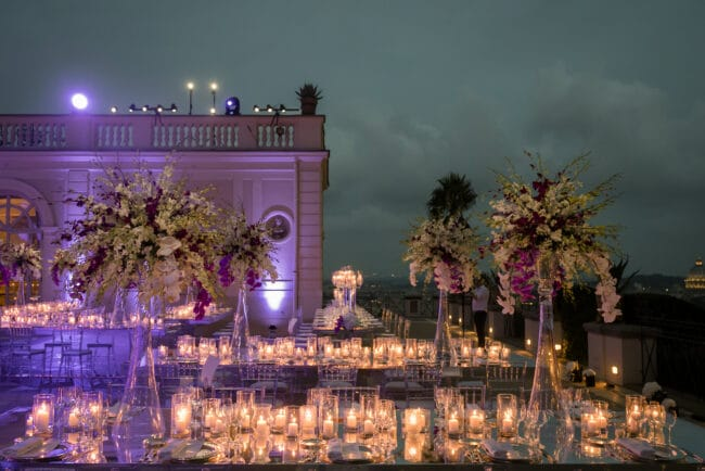 Mirror tables and orchids wedding decor