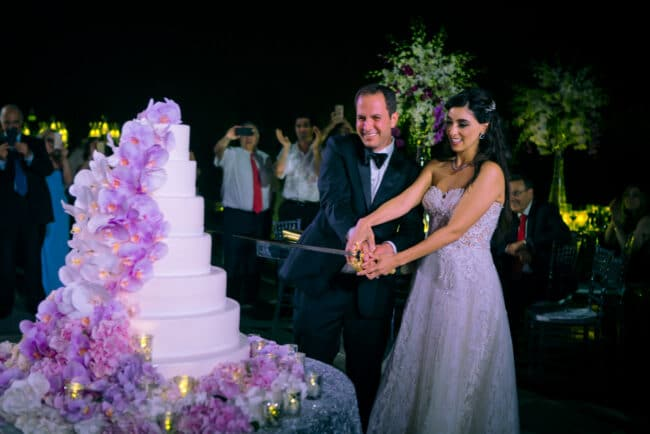 Cut of the wedding cake in Rome