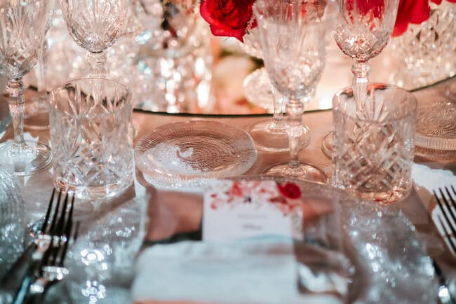 White and fuxia wedding table decoration