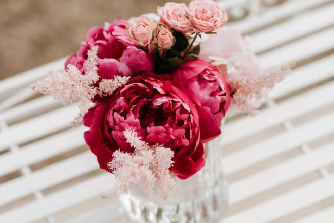 Fuxia flower decor for cocktail reception in Sicily