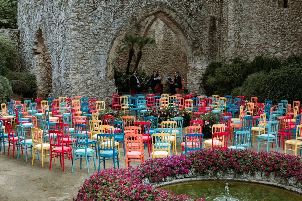 Garden wedding with colored chairs
