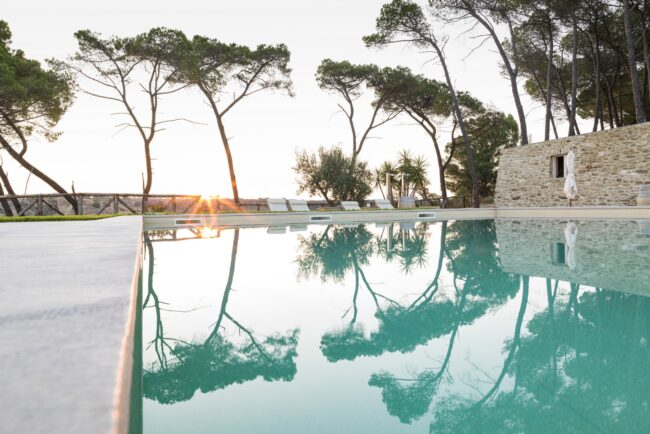 Poolside at sunset in a wedding venue in sicily