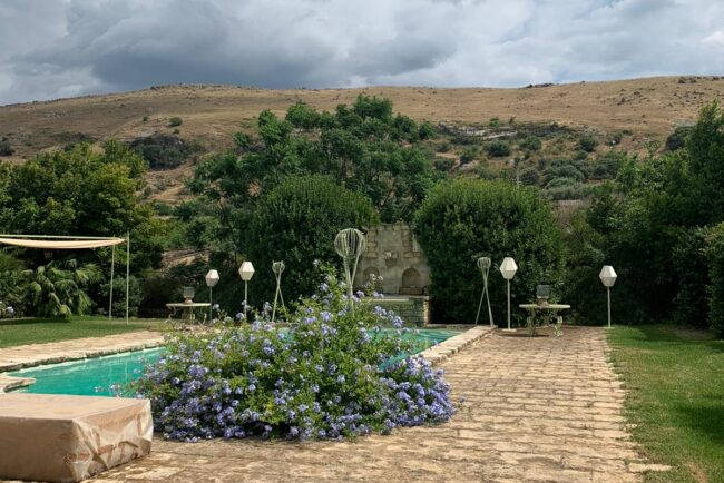 Sicilian view with the swimmingpool and decors