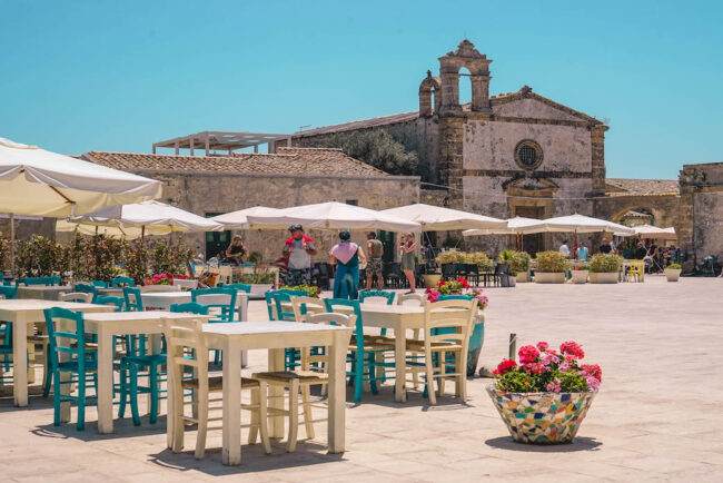 Table and chairs in a sicilian square