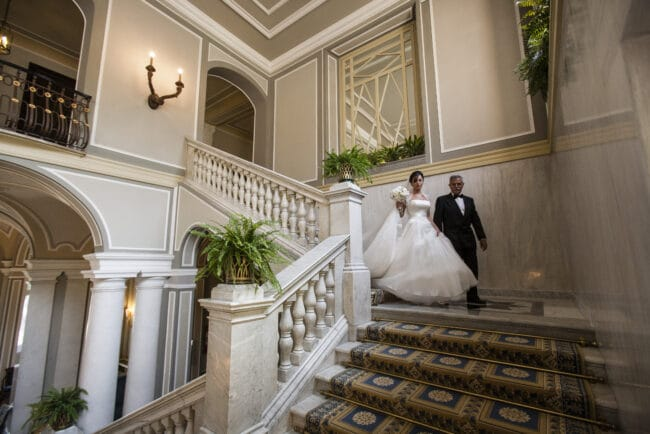 The newlyweds on the stairs at Villa d'Este in Lake Como