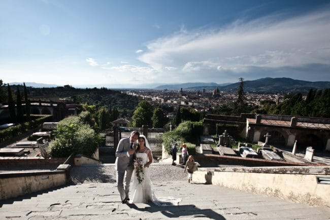 The bride and groom pose for a photo during their intimate wedding Florence